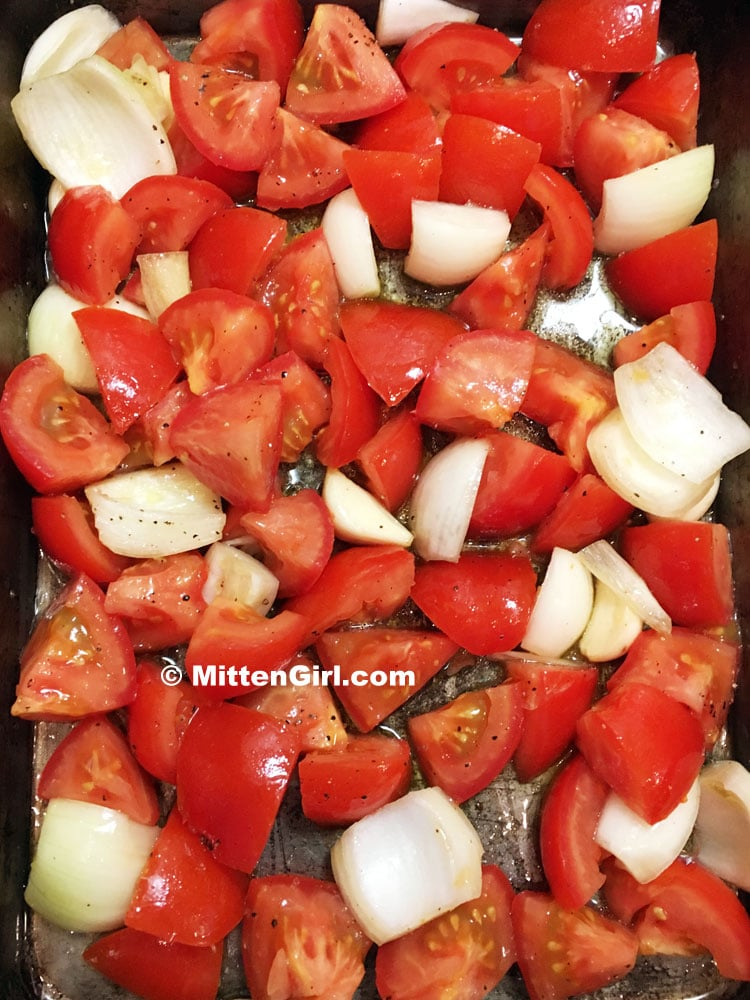 Vegetables chopped for roasted tomato sauce and ready for the oven.