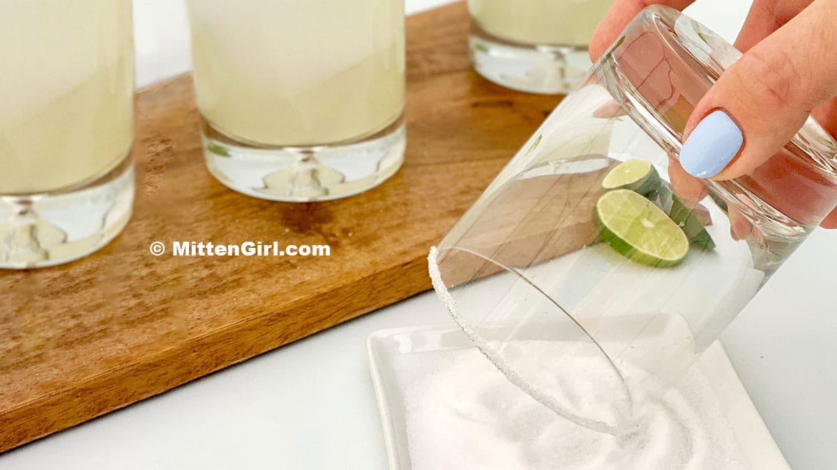 Salting the rim of a glass for homemade margaritas